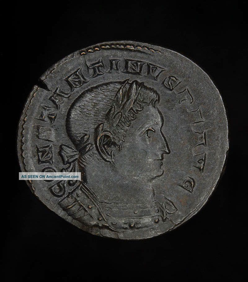 Ancient Roman Bronze Follis Sol Coin Of Christian Emperor Constantine The Great Roman photo