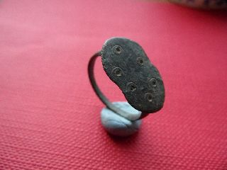 Ancient Bronze Roman Finger Ring. With Dot Design On It photo