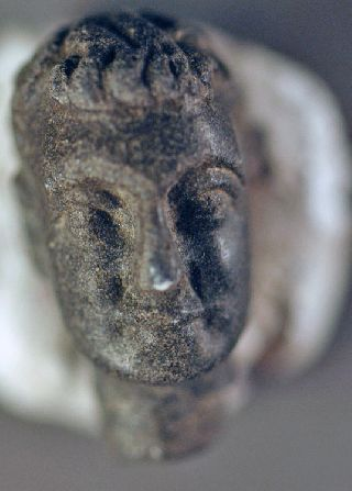 Household Idol Head. Roman Stone Over 1600 Years Old photo