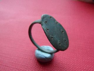 Ancient Bronze Roman Finger Ring. With Seven Dot Design On It photo