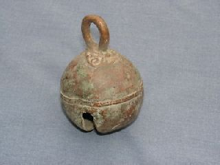 Large Ancient Bell With Ornate Design To Top And Centre photo