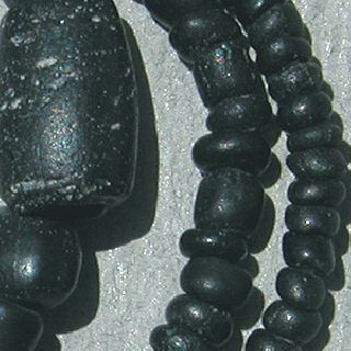 A Strand Of Ancient Black Glass Beads From Afghanistan photo