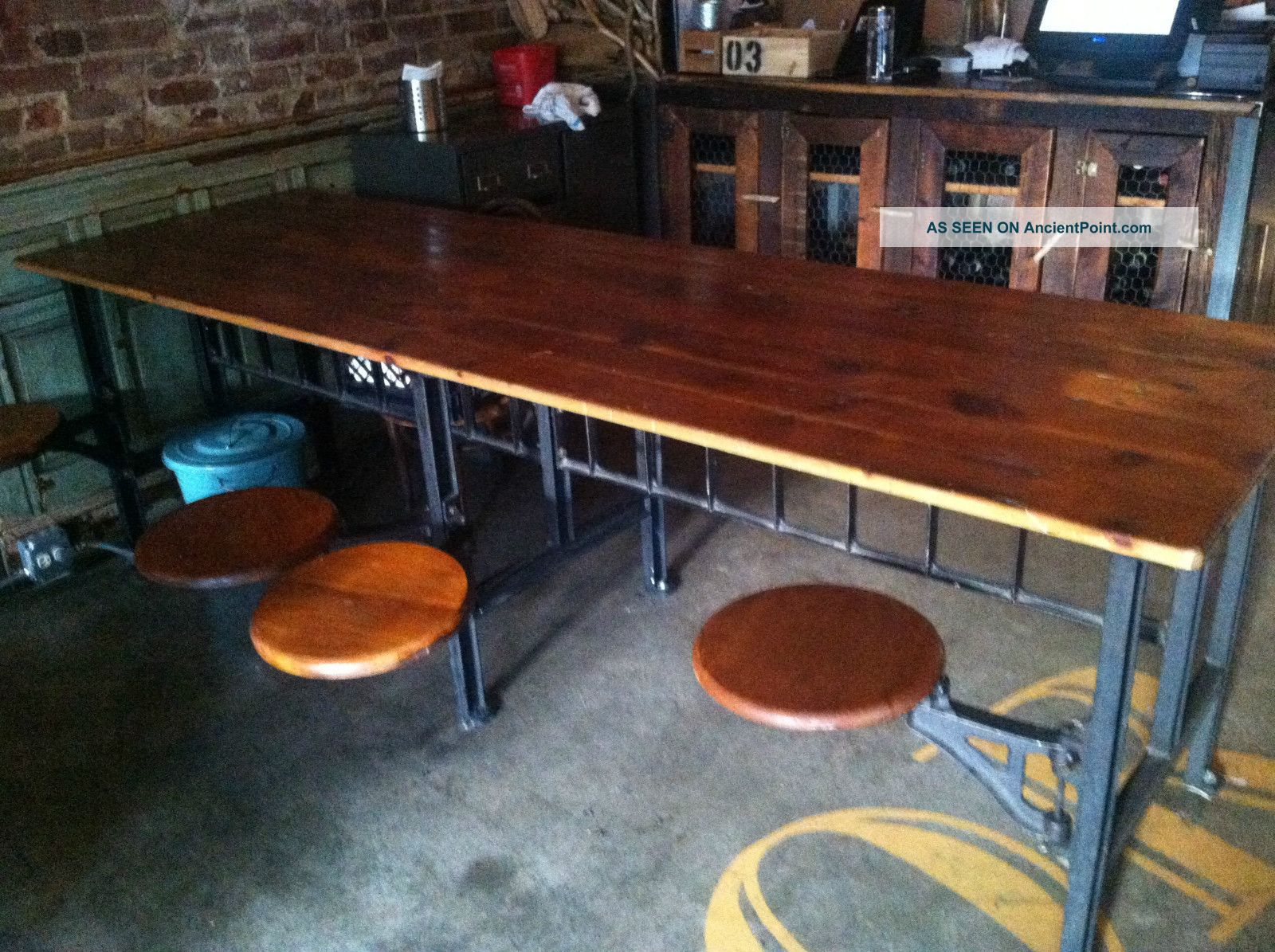 Industrial Table With 8 Swinging Stool Attached Post-1950 photo