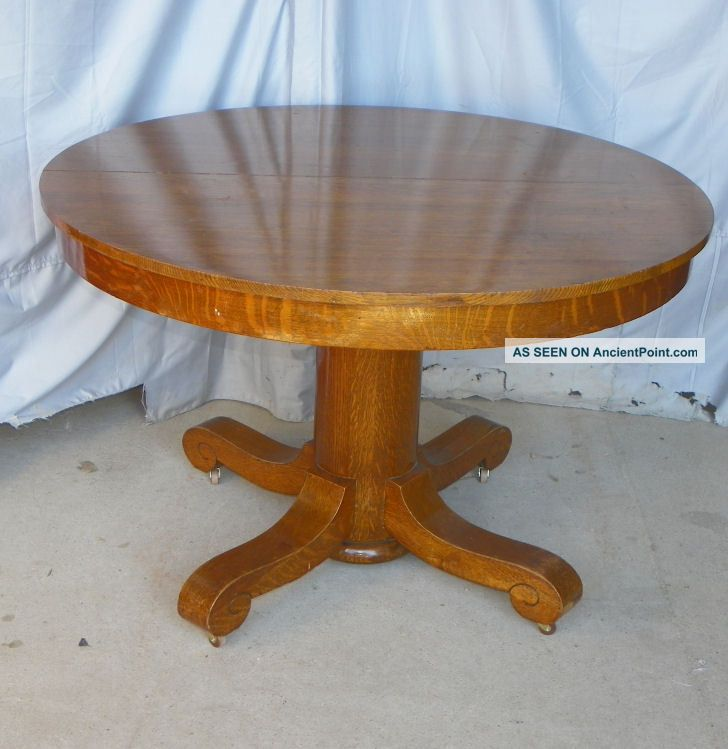 Antique Round Oak Dining Table - 3 Leaves 1900-1950 photo