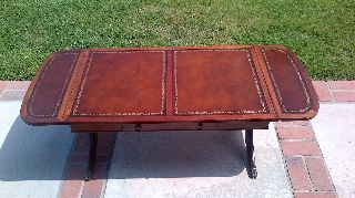 Antique English Leather Top Drop Leaf Coffee Table With Brass Claw Feet photo