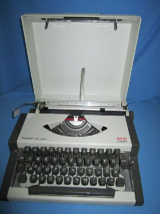 Vintage Aeg Olympia Traveller De Luxe Typewriter With Case Works Perfectly photo