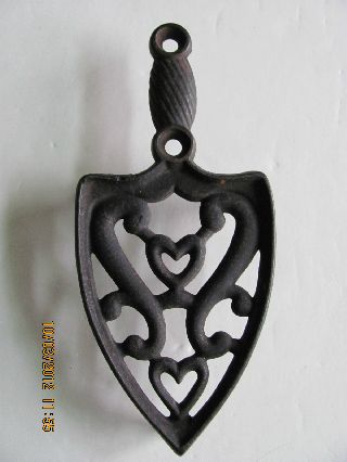 Antique Cast Iron Trivet With Heart Design photo
