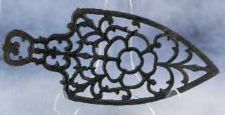 Vintage Antique Lacy 3 Legged Cast Iron Spade Shaped Sad Iron Stand Trivet photo
