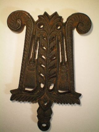 Old Vintage Signed Wilton Trivet Cast Iron Brooms Folk Art photo