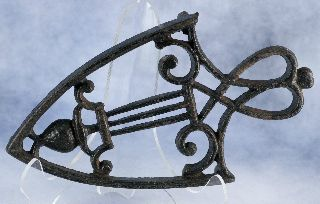 Vintage Antique Pineapple And Bars Cast Iron Spade Shaped Sad Iron Stand Trivet photo