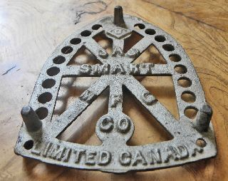 Vintage Trivet Collection Jas Smart Limited Canada Silver Paint Feet Cast Iron photo