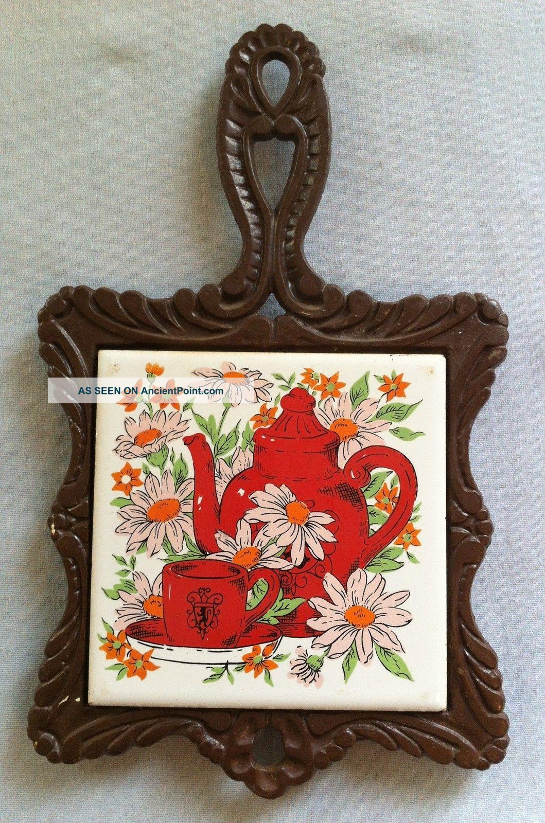 Vintage Cast Iron Tile Trivet (7 Seven Star) Teapot & Sunflower Design Trivets photo