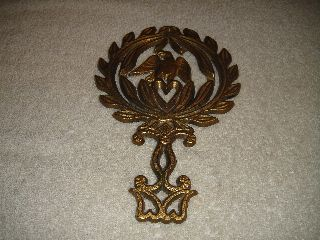 Antique J.  Z.  H.  Trivet - 1949 T - 13 Eagle - Gold Color - Eagle Grasping Heart Design photo