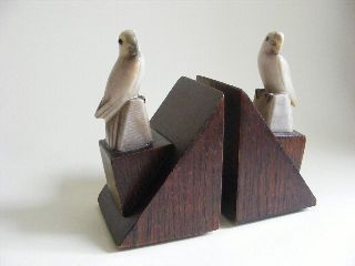 Pair Of Art Deco Wooden Bookens With Marble Parrot Detail photo