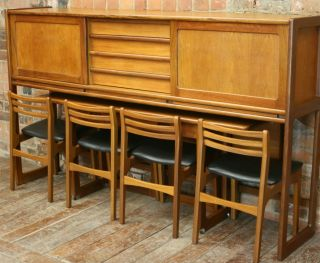 Danish Designed 1970s Teak Wall Unit Table And Chairs photo