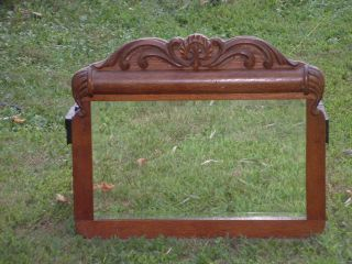 Beveled Mirror And Applied Carving Trim photo