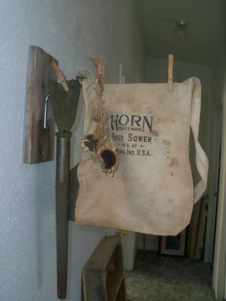 Vintage Inspired Old Horn Seed Sower Bag Wall Hanging photo