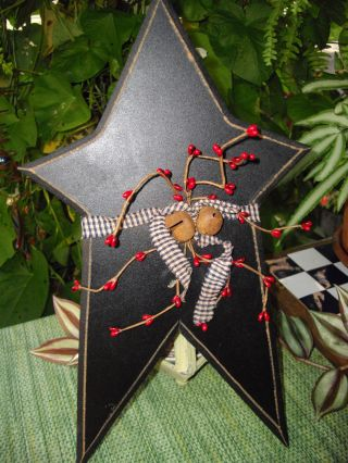 Primitive Style Star With Berries,  Jingle Bells And Homespun Ribbon photo
