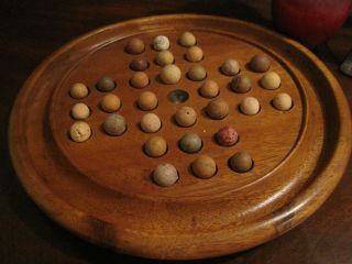 Antique 1800s Wooden Hand Turned Solitaire Game Board W Antique Clay Marbles photo