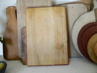 The Best Antique Bread Board With Beveled Edge And Old Red Paint photo