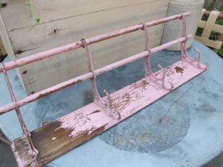 Antique Wall Mounted Hat Rack,  Oak And Cast Iron,  But Now Painted Pink photo
