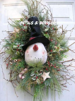Country Christmas,  Winter Snowman Door Wreath Arrangement photo