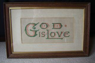 God Is Love Old Paper Punch Sampler In Wooden Frame photo