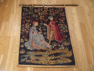 Old Colourful Tapestry On Brass Decorative Hanging Bar photo