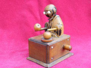 Japanese Wooden Kobe / Kobi Toy.  Man Eating Apple. photo