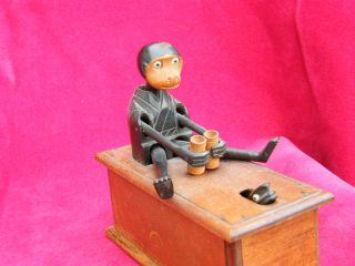 Japanese Wooden Kobe / Kobi Toy.  Monkey With Binoculars And Snake. photo