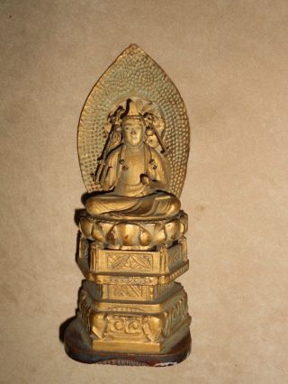 A Japanese Buddha Figure photo