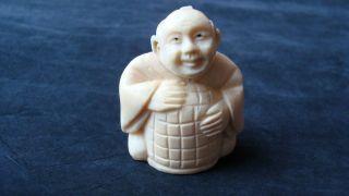 Old Japanese Ox - Bone Netsuke Man With Basket - Signed photo