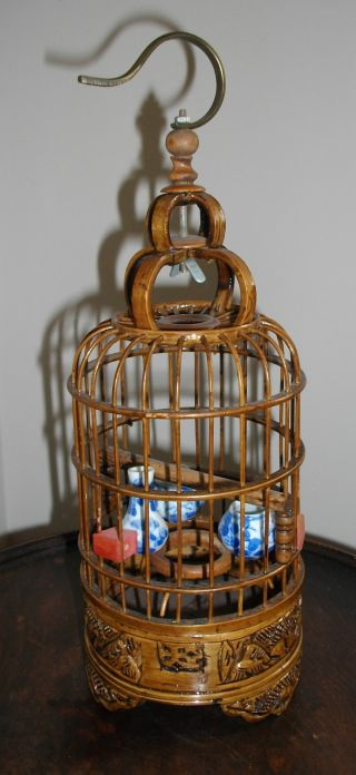 A Chinese Carved Bamboo Birdcage With 3 Miniature Blue & White Vessels Inside photo