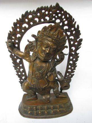 Old Chinese Buddhist Statue Of Vajrapani photo