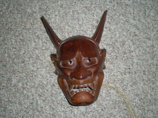 Hand Carved Wooden Hannya Mask photo