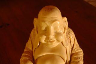 Antique Hotei Statue photo
