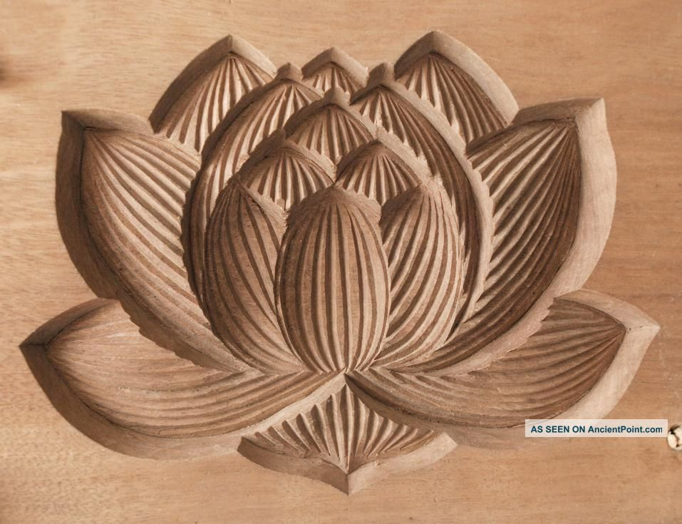Hand carved wooden flowers designs
