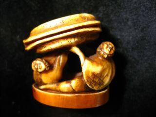 Japanese Carved Netsuke: Couple Lifting photo