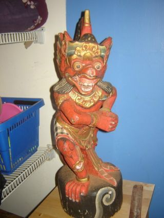 Balinese Statue Carved Wood,  Red Demon photo