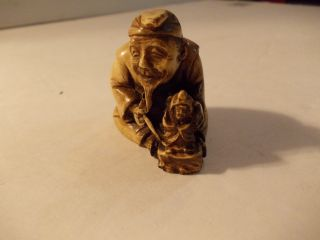 Netsuke Carving Of A Netsuke Carver photo