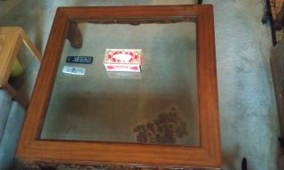 A Large Carved Wood Tea Table With Glass Top photo
