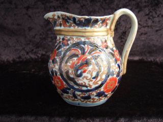 19th Century Japanese Imari Jug.  12.  5 Cms Tall.  Displays Well But A/f. photo