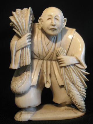 Antique Japanese Carved Ox Bone Netsuke Of A Peasant W.  Wheat Carving photo