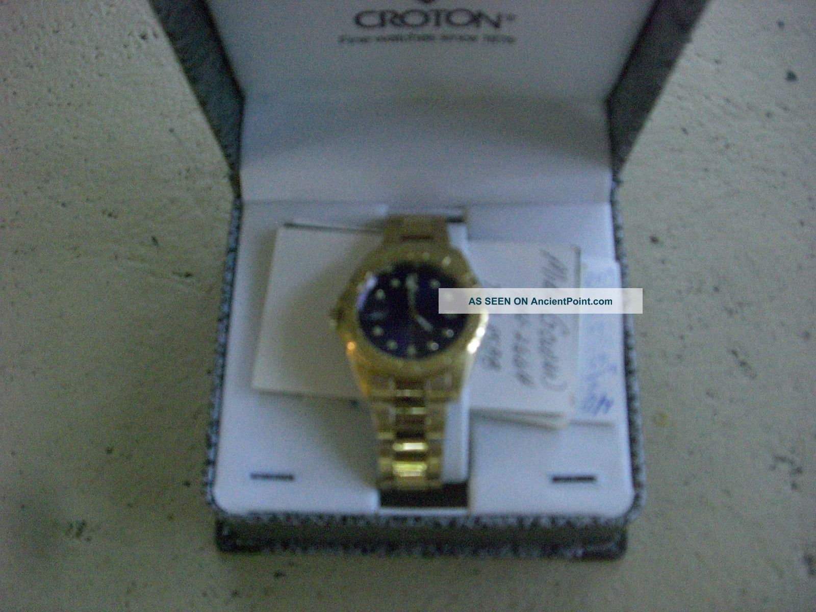 Croton Mens Watch With Date Boxes photo