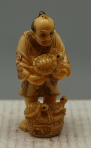 Hand Carved Japanese Man Netsuke - ' The Turtle Seller ' - Signed photo