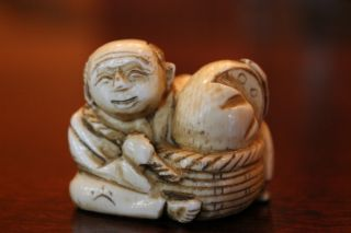 Signed Vintage Japanese Carved Netsuke Figure Farmer With A Melon In A Basket. photo