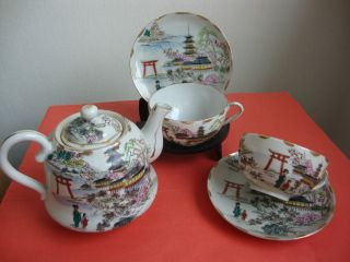 A Japanese Hand Painted Tea Pot & Cups & Saucers photo