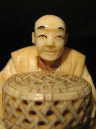 Antique Japanese Inked Ox Bone 象牙 Netsuke Of A Sitting Man W.  A Basket,  Signed photo
