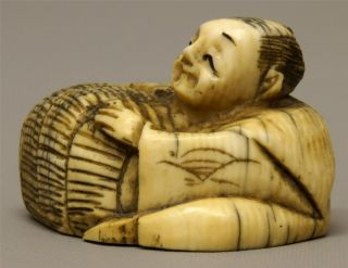 19th C Meiji Japanese Carved Cow Bone Netsuke - Man & Basket photo