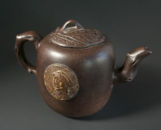 A Yixing Teapot With Calligraphy And A Mao Portrait photo